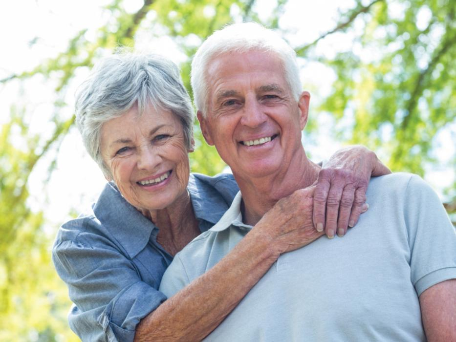 Older couple smiling outside | Dentures in Wausau WI