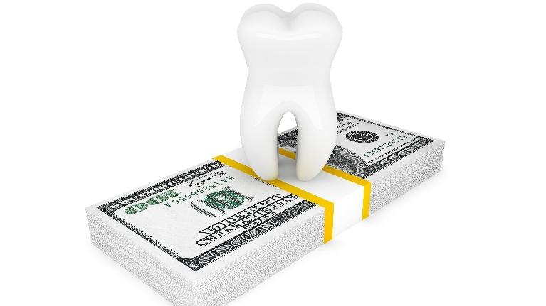 Tooth on top of stack of money | Dental Maintenance in Wausau WI | Dr. James S. Kim, DDS